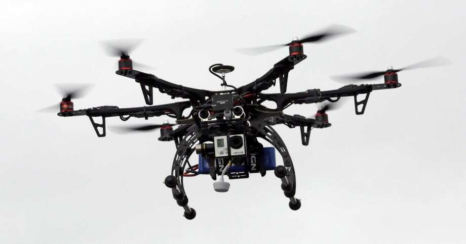 The Federal Aviation Administration now requires owners of many small drones and model airplanes to register them with the government, in response to increasing reports of drones flying near manned aircraft and airports. Photo: Rick Bowmer, Associated Press