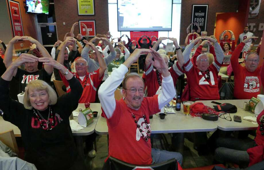 Members of the Ohio State University football fan club gather for their Kegs and Eggs breakfast before they watch the Ohio State versus Michigan football game at Buffalo Wings & Rings on Loop 1604 on Saturday, Nov. 28, 2015. Photo: Billy Calzada /San Antonio Express-News / San Antonio Express-News