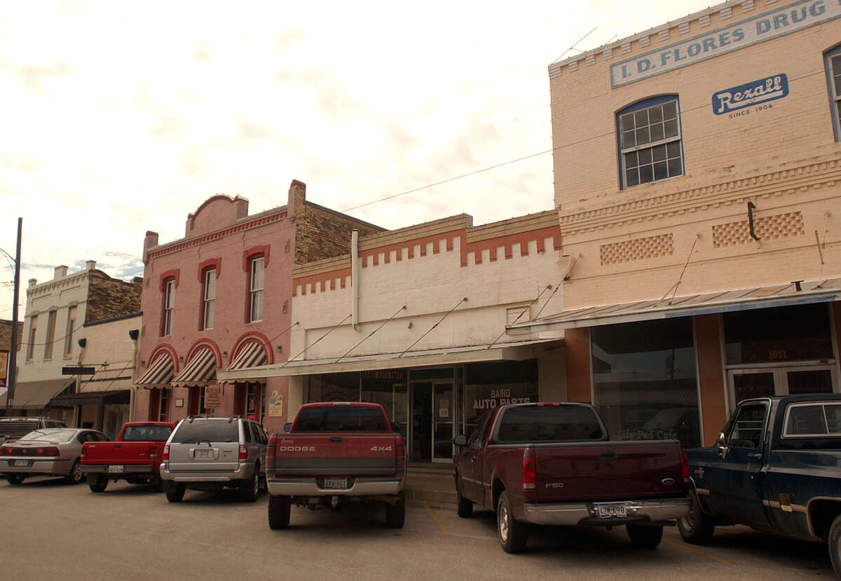 Downtown Floresville has several historic buildings, touted as a major part of the city's small-town charm. A legal battle over a city councilman's residency has roiled local politics; a judge ruled this week that Councilman Jim Miller didn't meet residency requirements but can hold the seat to which he was elected in November until a special election is held in May.