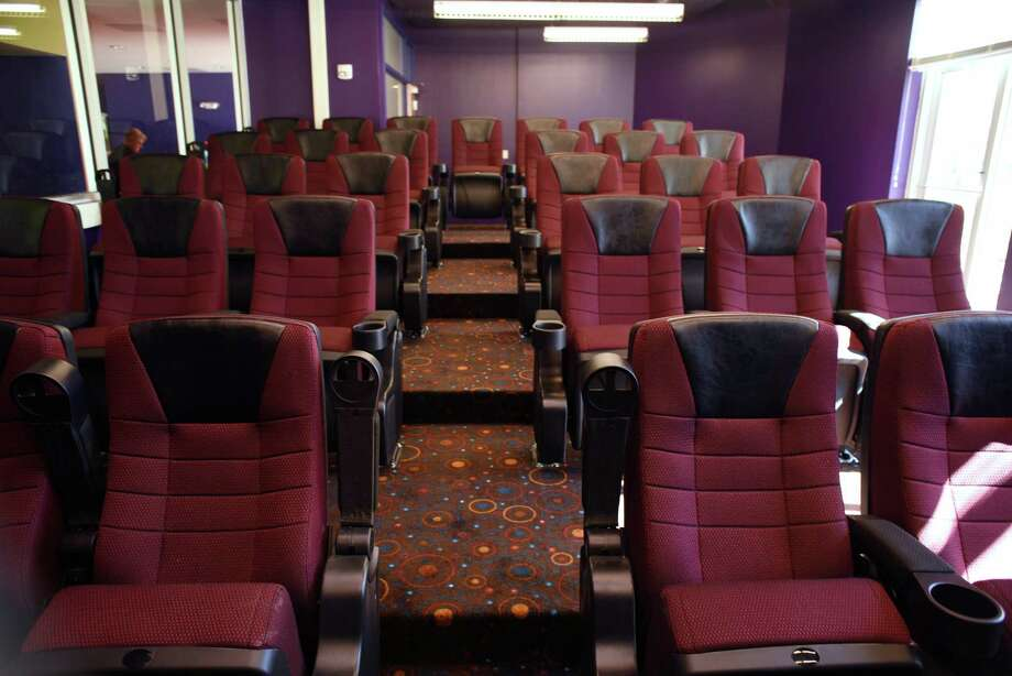 The Children's Shelter has a new 31-seat theater. It opened Tuesday, much to the surprise of the children who live there. Photo: Billy Calzada /San Antonio Express-News / San Antonio Express-News