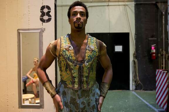 Daniel Deivison-Oliveira, a soloist with the San Francisco Ballet, gets into costume for his part in the Arabian dancers scene during a dress rehearsal for the Nutcracker at the War Memorial Opera House on December 17, 2015 in San Francisco, Calif.  Originally from Brazil, the Nutcracker was the first ballet Deivison-Oliveira performed in when he moved to San Francisco in 2004. Since then, he has performed over ten different roles in the Nutcracker. He became a soloist with the San Francisco Ballet in 2011.