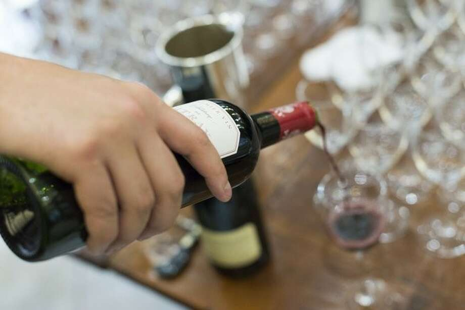 Wine is poured at the October grand opening of Putnam and Vine at 39 East Elm Street in Greenwich. Photo: Contributed