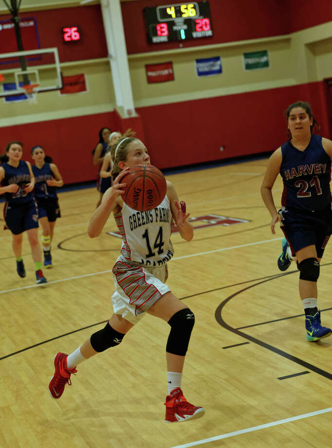 Greens Farms Academy freshman Katherine Marcus (New Canaan) gets a fast break in her team's victory over The Harvey School on Dec. 17. Photo: Contributed / New Canaan News