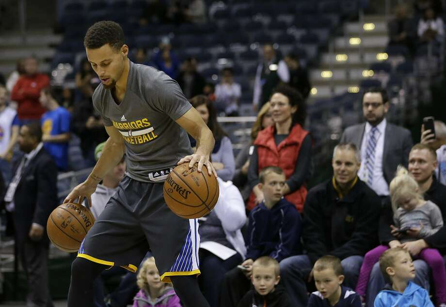 Golden State Warriors' Stephen Curry warms up before an NBA basketball game against the Milwaukee Bucks Saturday, Dec. 12, 2015, in Milwaukee. (AP Photo/Aaron Gash) Photo: Aaron Gash, Associated Press