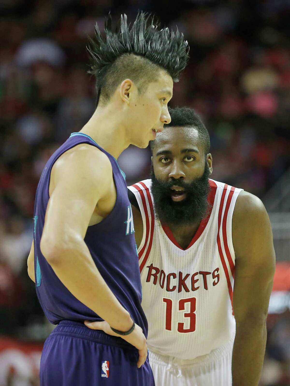 Houston Rockets guard James Harden (13) eyes Charlotte Hornets guard Jeremy Lin (7) in second half on December 21, 2015 at the Toyota Center in Houston. Rockets won 102 to 95.