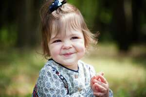 Cute smiling baby girl clapping with hands