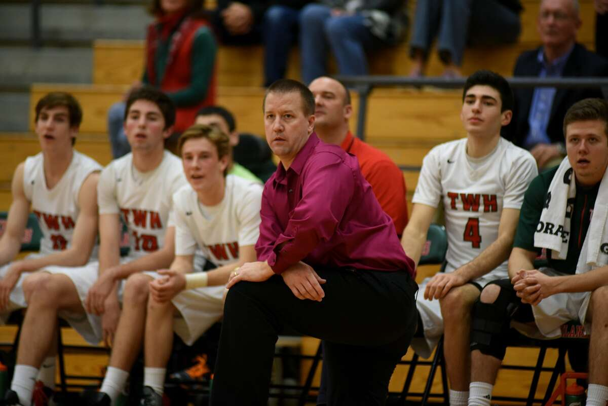 The Woodlands head coach Dale Reed, center, watches his team play against Clear Falls during their non-district match-up last week.