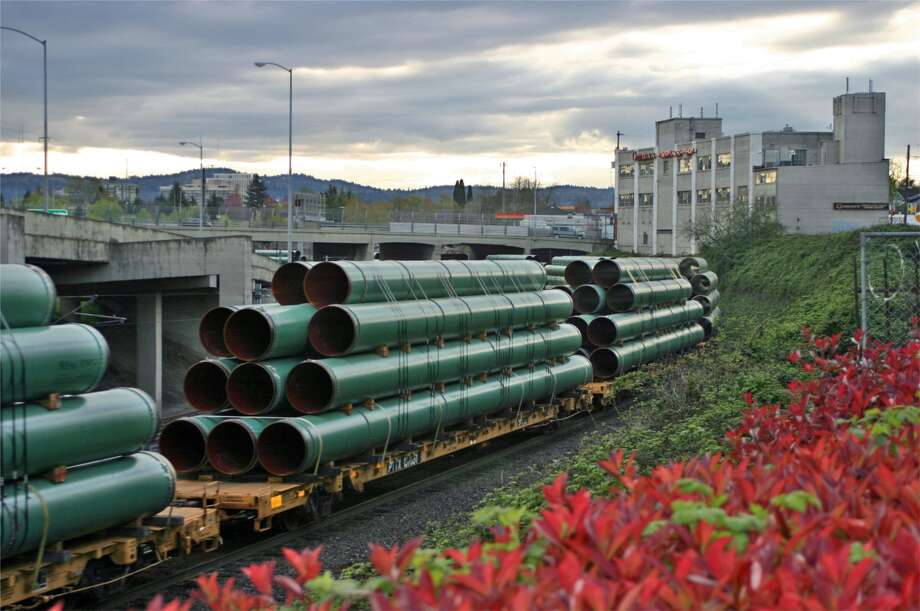 A load of pipe travels by train. The growth model for some pipeline companies has become difficult to sustain.