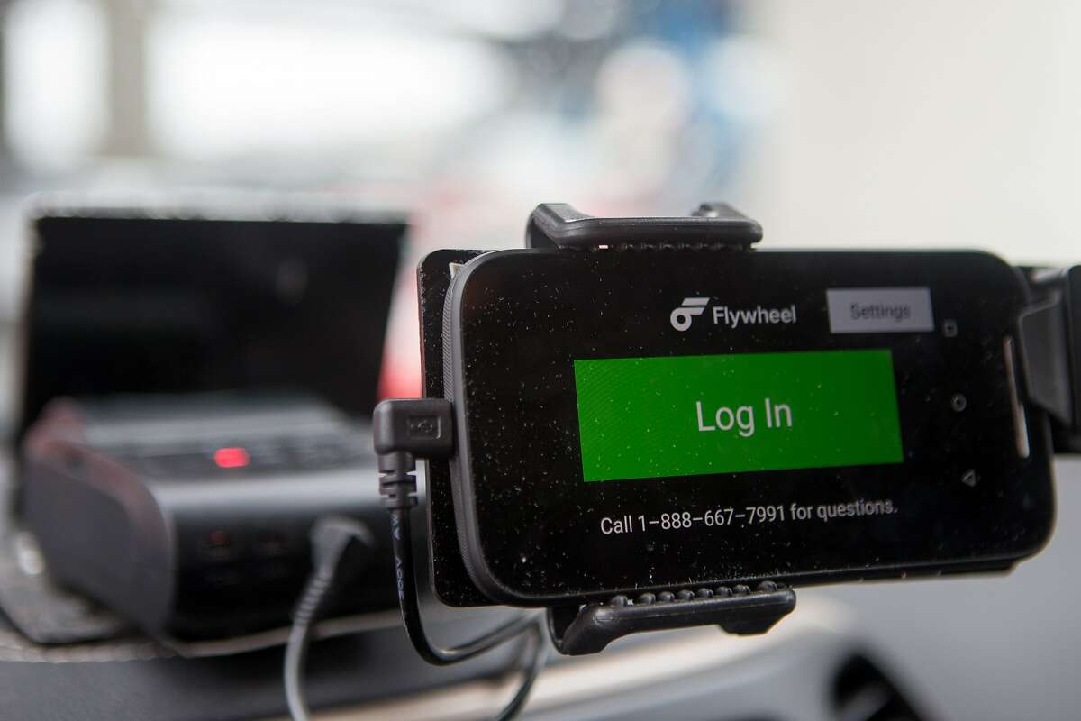 The new TaxiOS metering system which includes only the phone and a printer is seen on Monday, Dec. 21, 2015 in San Francisco, Calif.