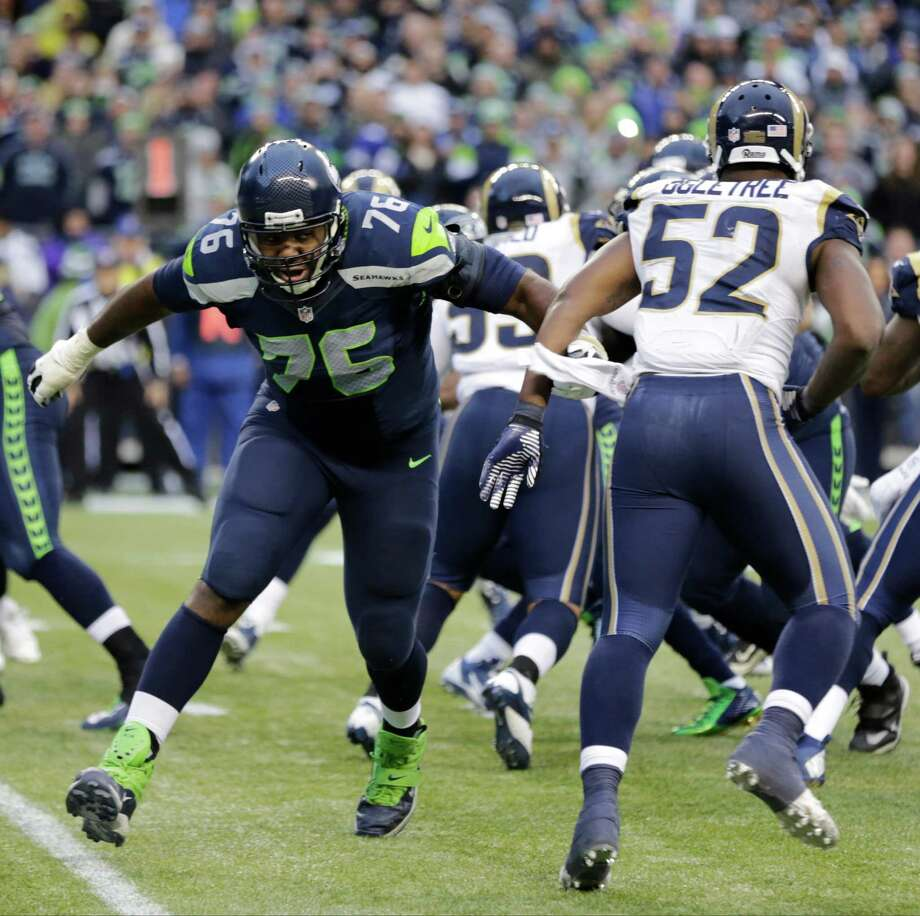 Seattle Seahawks offensive tackle Russell Okung (76) squares off against St. Louis Rams linebacker Alec Ogletree (52) in the second half of an NFL football game, Sunday, Dec. 28, 2014, in Seattle. Photo: Scott Eklund, Associated Press / FR171040 AP