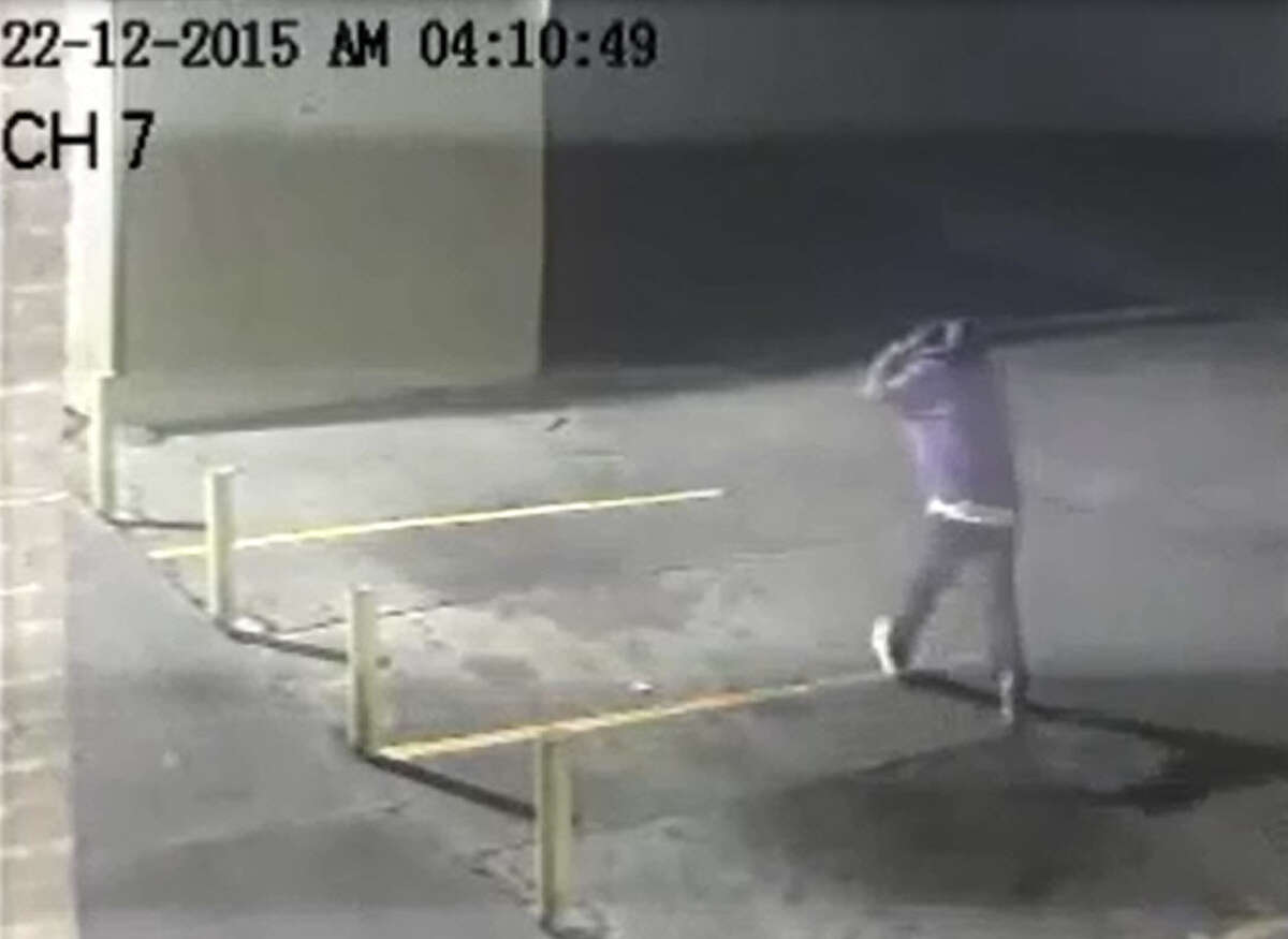 Surveillance photos show two men sneaking up on a security guard sitting in his patrol car at a gas station in the 4700 block of Anderson and fatally shooting him Dec. 22, 2015.