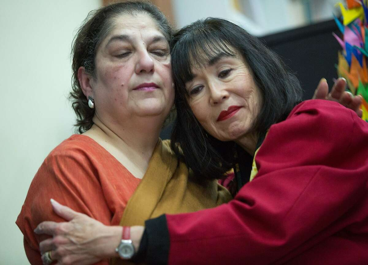 Karen Korematsu, right, comforts Samina Sundas during a news conference at the National Japanese American Historical Society in Japantown, Tuesday, Dec. 22, 2015, in San Francisco, Calif. Korematsu is the founder and executive director of the Fred T. Korematsu Institute. Sundas is the founder and executive director of American Muslim Voice. Japanese Americans from the Bay Area Day of Remembrance Consortium and their supporters expressed support and solidarity with the Muslims, Sikh, Arab and South Asian American communities.
