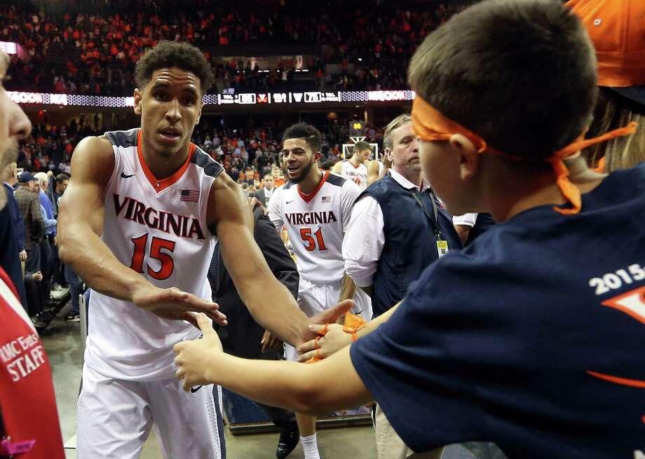 Virginia guard Malcolm Brogdon (15) greets fans after the 86-75 win over Villanova Saturday Dec. 19, 2015, in Charlottesville, Va. (AP Photo/Andrew Shurtleff) Photo: ANDREW SHURTLEFF / Associated Press / FR82550 AP
