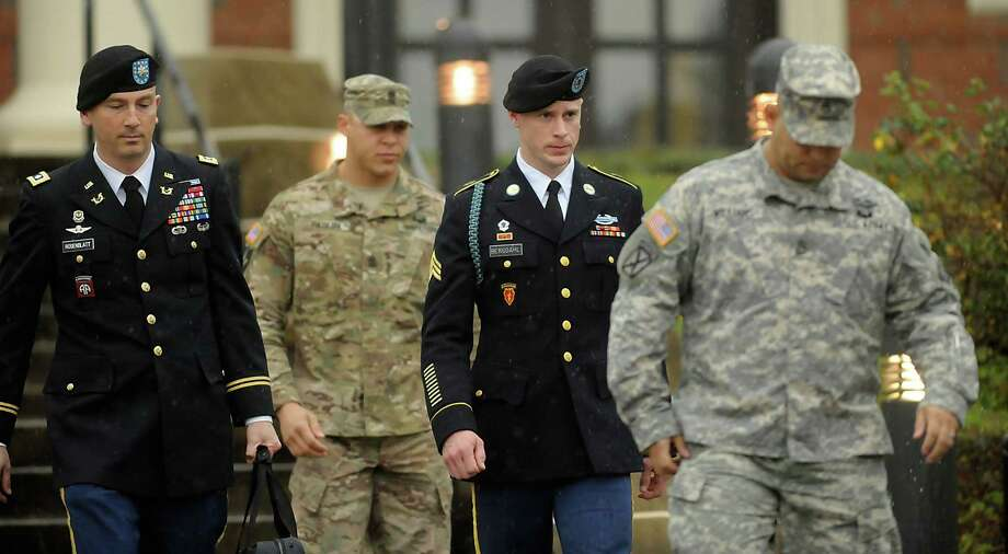 FT. BRAGG, NC - DECEMBER 22: Army Sgt. Bowe Bergdahl (2nd R) of Hailey, Idaho, leaves a military courthouse with his attorney Lt. Col. Franklin Rosenblatt (L) on December 22, 2015 in Ft. Bragg, North Carolina. Bergdahl was arraigned on charges of desertion and endangering troops stemming from his decision to leave his outpost in Afghanistan in 2009. He was captured by the Taliban and spent five years in captivity before being freed in a prisoner exchange. (Photo by Sara D. Davis/Getty Images) Photo: Sara D. Davis, Stringer / Getty Images / 2015 Getty Images