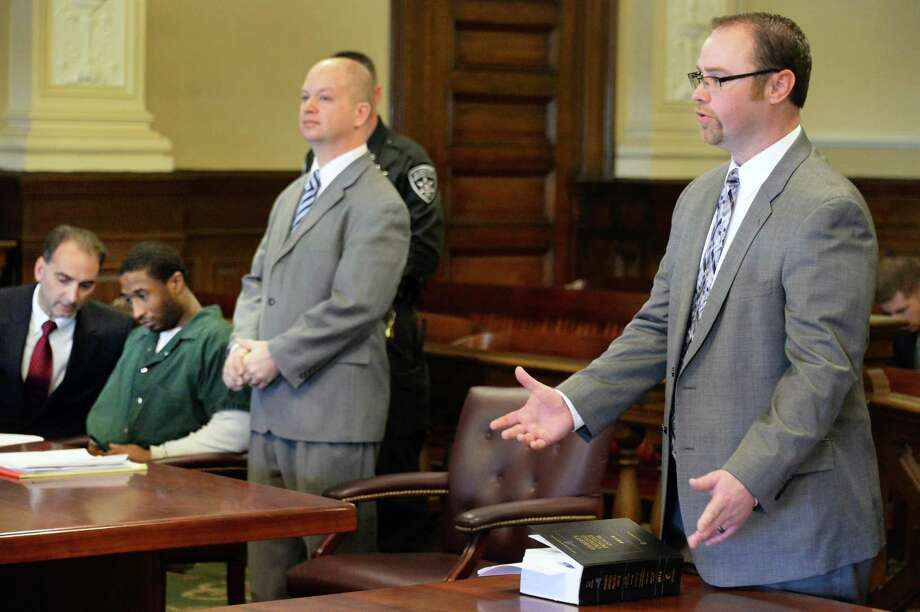 From left, Rensselaer County Public Defender John Turi, left, defendant Paul Walker, defense attorney William Roberts and Assistant District Attorney Shane Hug address the court during Walker's  appearance before Judge Andrew Ceresia Thursday, Feb. 5, 2015, at the Rensselaer County Courthouse in Troy, N.Y. (John Carl D'Annibale / Times Union) Photo: John Carl D'Annibale / 00030487A
