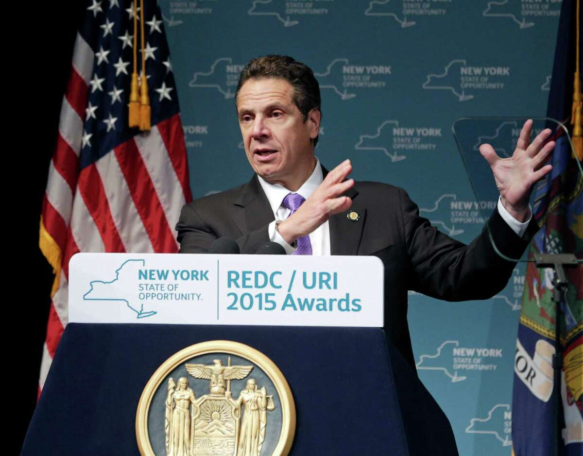 """FILE - In this Dec. 10, 2015, file photo, New York Gov. Andrew Cuomo speaks during an economic development awards ceremony in Albany, N.Y. After the NYCLU filed its lawsuit in 2011, Cuomo saw it as an opportunity to improve New York's prison standards and instructed his staff to negotiate. New York prison officials agreed Wednesday, Dec. 16, 2015, to overhaul their use of solitary confinement, offering a broad slate of reforms aimed at reducing the number of inmates sent to """"the box,"""" limiting the amount of time they can spend there and providing counseling to help long-term solitary inmates adjust to life on the outside. (AP Photo/Mike Groll, File) ORG XMIT: NYR102"""