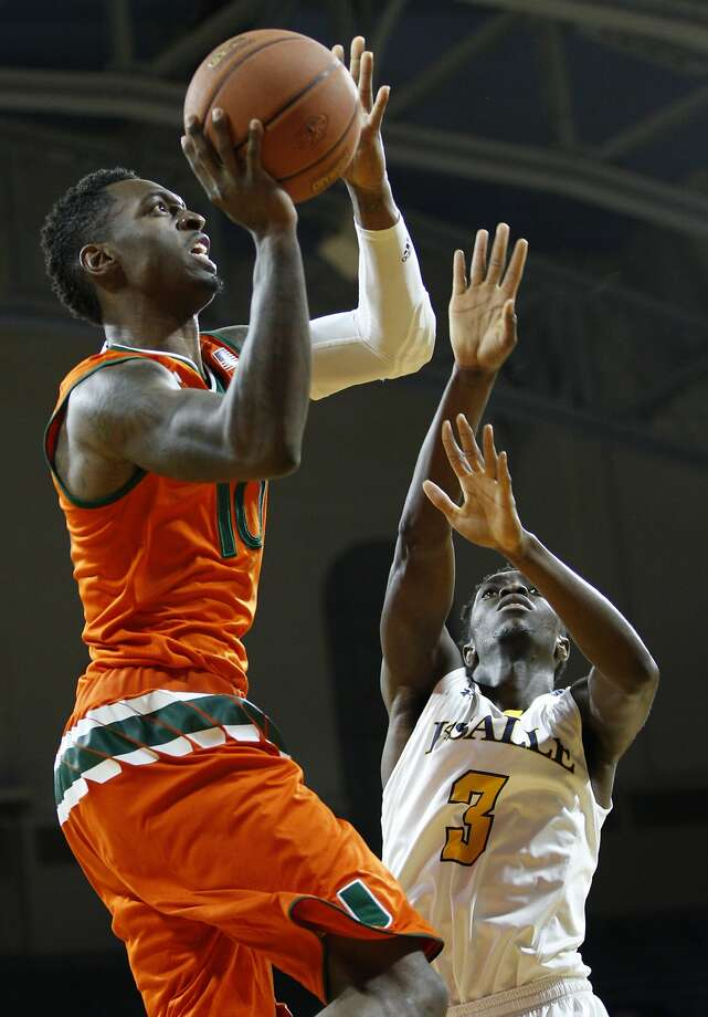 Miami's Sheldon McClellan, left, goes up and over the defense to score two of his 14 points for the surging Hurricanes. Photo: Chris Szagola, Associated Press