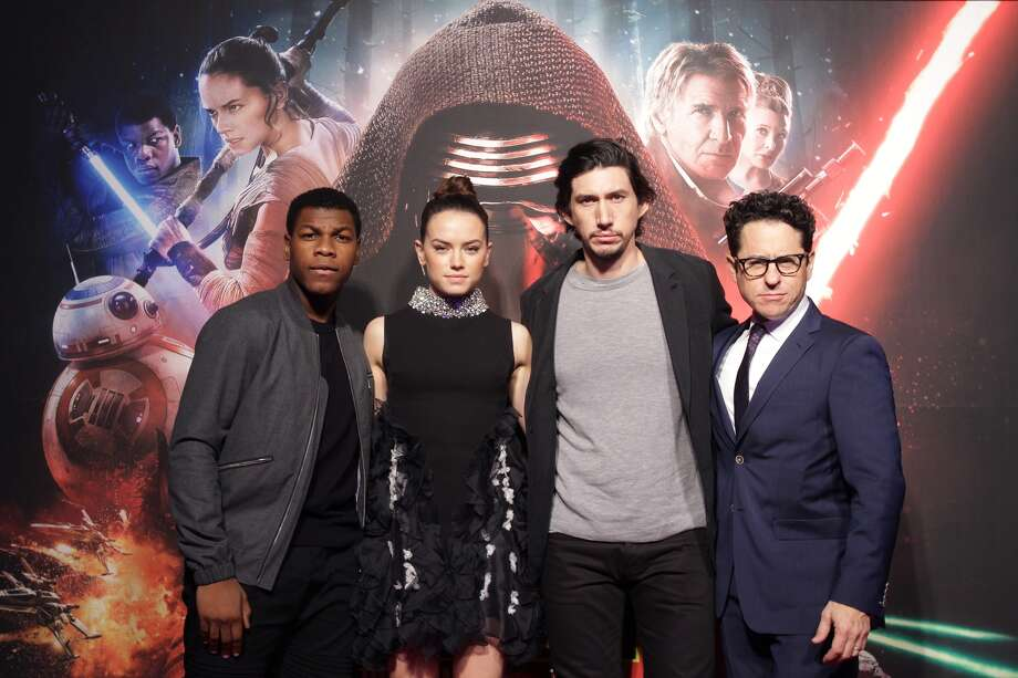 L to R) Actor John Boyega, actress Daisy Ridley, actor Adam Driver and director J.J. Abrams attend the event for fans ahead of 'Star Wars: The Force Awakens' South Korea premiere at the Octagon on December 9, 2015 in Seoul, South Korea. (Photo by Chung Sung-Jun/Getty Images for Walt Disney Studios)
