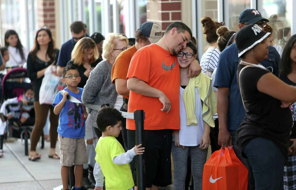 Shoppers line up to enter Michael Kors store at Houston Premium Outlets Tuesday, Dec. 22, 2015, in Cypress, Texas. The store was offering 40% off entire purchase. ( Gary Coronado / Houston Chronicle )