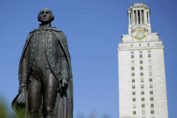 A statue of George Washington stands near the University of Texas at Austin tower at the center of campus. UT is looking to expand into Houston.
