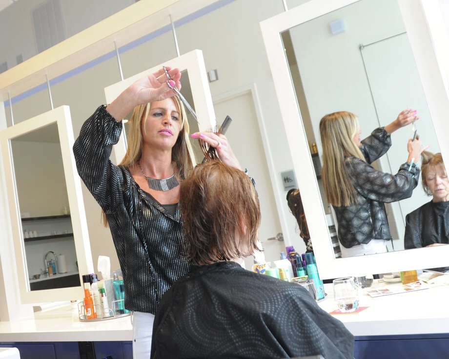 Hairdresser Kerry Crowley takes care of Judy Hart earlier this year in Stamford, Conn. Research has shown that women often spend more than men on haircuts that require the same amount of labor as men's styles.  Photo: Tyler Sizemore, Staff Photographer / Greenwich Time