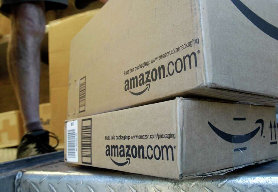 Amazon users who are not members of Amazon Prime now must spend $49 for no-charge shipping. However, orders that contain $25 of books will be delivered without a charge. Photo: Associated Press File Photo / AP
