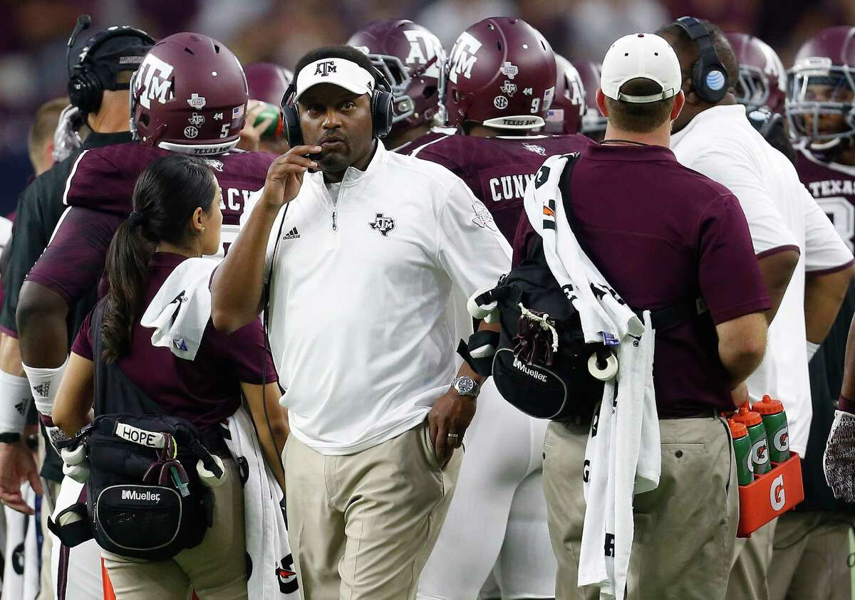 Texas A&M head coach Kevin Sumlin works the sidelines during the first half against Arizona State game at NRG Stadium in Houston on Sept. 5, 2015.