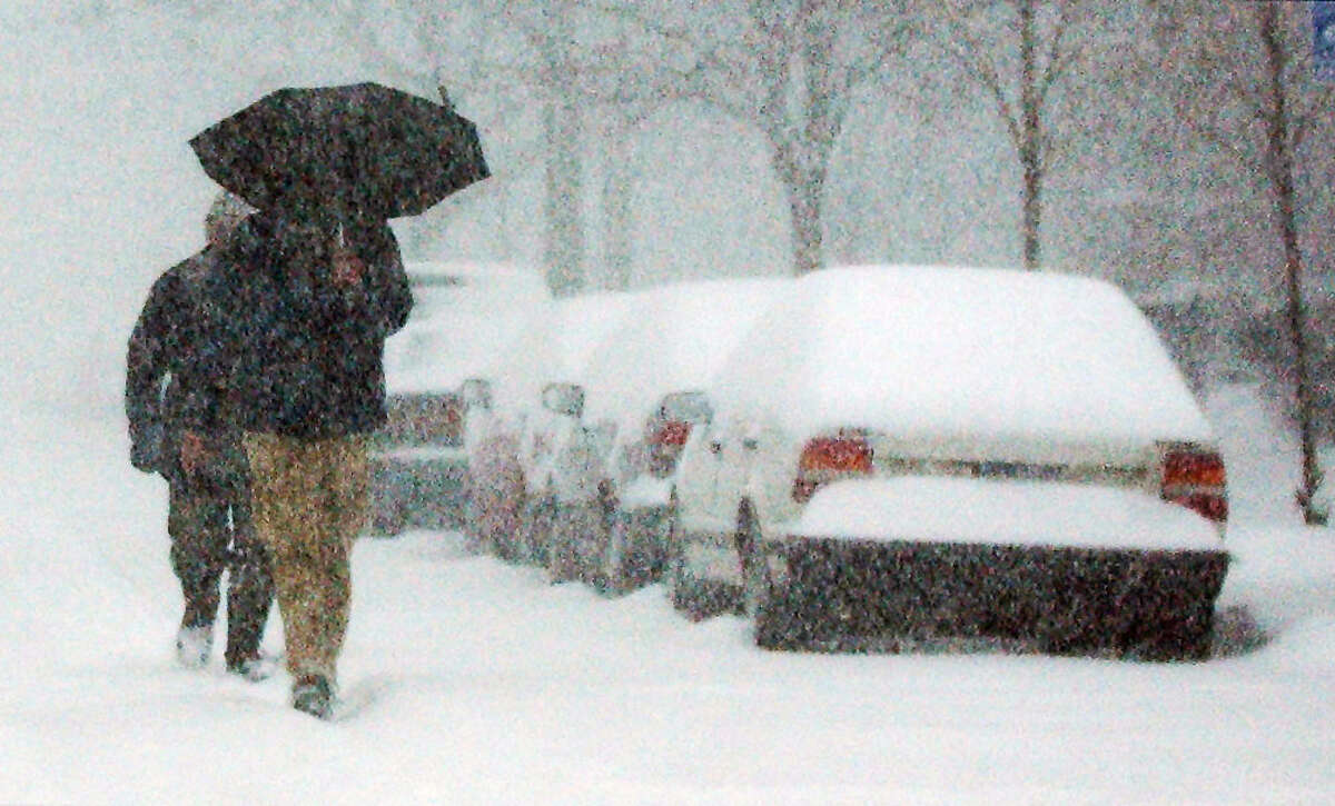 Pedestrians walk along State Street near the Capitol during a Christmas Day snowstorm on Dec. 25, 2002, in Albany, N.Y. (James Goolsby/Times Union archive)