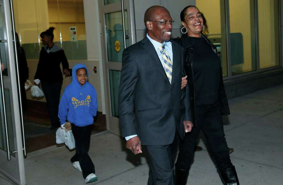 Clarence Moses-EL, front, walks out of the Denver County jail with his wife, Stephanie Burke, Tuesday, Dec. 22, 2015, in Denver. A judge cleared the way for Moses-EL, who has spent 28 years behind bars for a rape he says he did not commit, setting bond that will allow him to walk free. (AP Photo/David Zalubowski) Photo: David Zalubowski, STF / AP