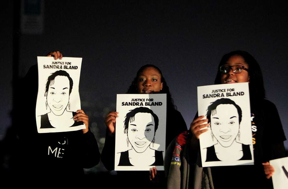 Activists hold signs with a picture of Sandra Bland during a rally at Hermann Park on Tuesday. Photo: Mark Mulligan, Houston Chronicle / © 2015 Houston Chronicle