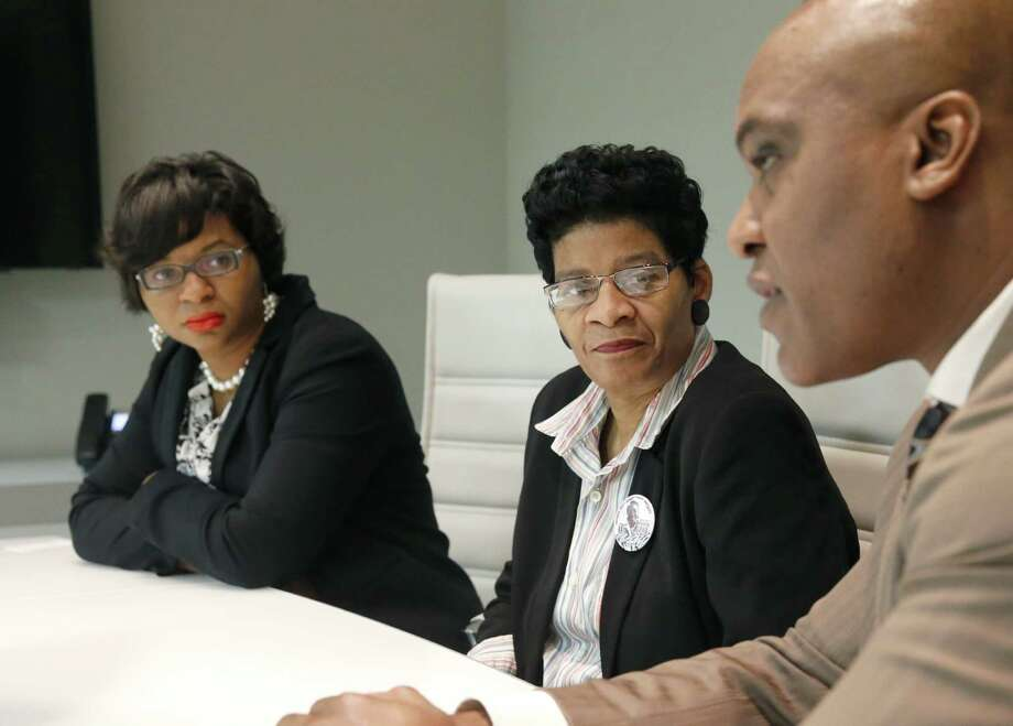 Sharon Cooper, sister of Sandra Bland, left, and her mother, Geneva Reed-Veal, listen to family attorney Cannon Lambert during an interview with the Associated Press on Tuesday, Dec. 22, 2015, in Chicago. A Texas grand jury decided that neither sheriff's officials nor jailers committed a crime in the treatment of Bland, a black woman who died in a Texas county jail last summer. (AP Photo/Charles Rex Arbogast) Photo: Charles Rex Arbogast, STF / Associated Press / AP