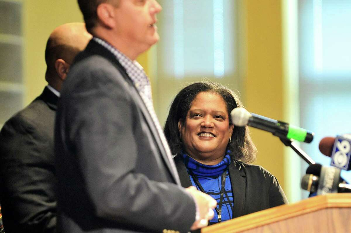 Albany School Superintendent Marguerite Vanden Wyngaard, Ph.D., listens as Albany County Sheriff Craig Apple addresses those gathered during a press conference at Hackett Middle School on Wednesday, October 28, 2015 in Albany, N.Y. Albany officials, community leaders, and parents held the event to show their support for the school and announce a renewed commitment to its success. The school has been identified by New York State as persistently struggling. (Paul Buckowski / Times Union)