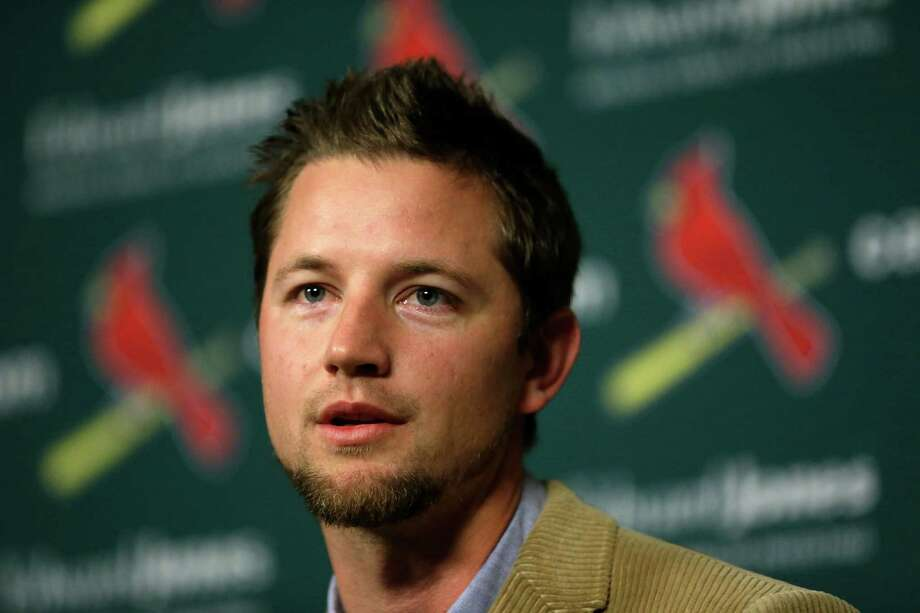 Free-agent pitcher Mike Leake takes part in a news conference announcing he has agreed to a contract to play baseball for the St. Louis Cardinals Tuesday, Dec. 22, 2015, in St. Louis. (AP Photo/Jeff Roberson) Photo: Jeff Roberson, STF / AP