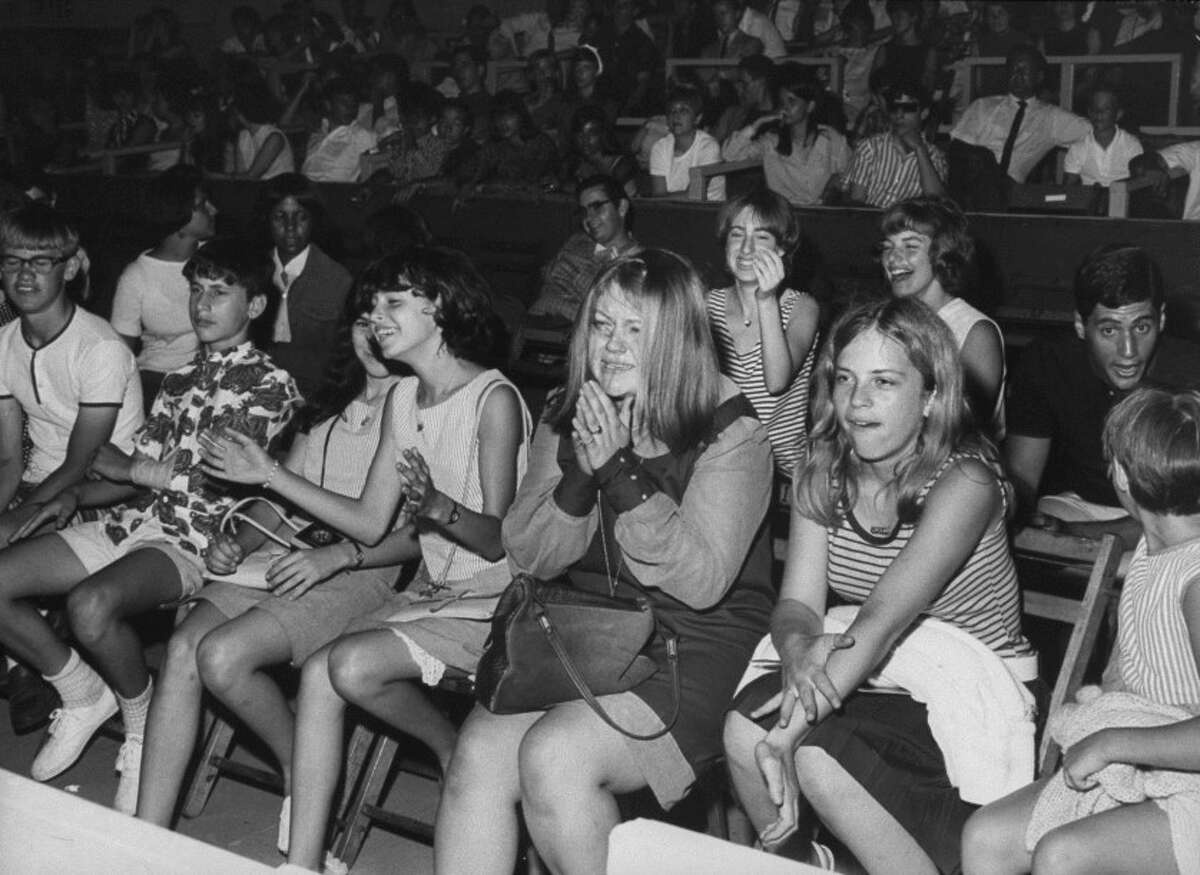 Teens are shown at a Rolling Stones concert in 1966.