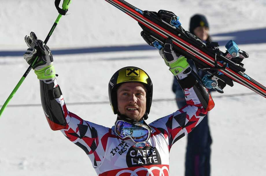 Austria's Marcel Hirscher celebrates as he won the FIS Alpine Skiing World Cup Men's Giant Slalom on December 20, 2015 in Alta Badia, northern Italy. AFP PHOTO / OLIVIER MORINOLIVIER MORIN/AFP/Getty Images Photo: OLIVIER MORIN, Staff / AFP or licensors