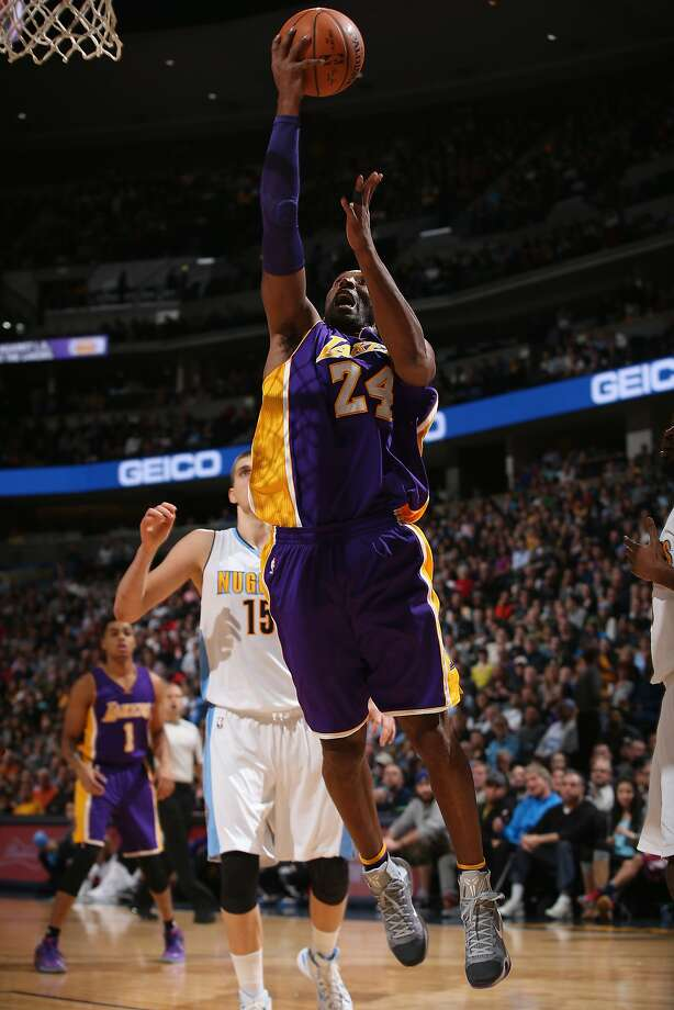 Kobe Bryant, on his way to 31 points, lays up a shot against Denver's Nikola Jokic. Photo: Doug Pensinger, Getty Images