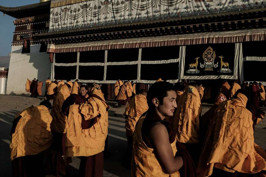 TOPSHOT - To go with China-Tibet-unrest-politics-dissent by Benjamin Haas In this photo taken on December 10, 2015, Tibetan monks prepare for a prayer session at Kirti Monasterys main hall in Aba, a Tibetan area of Chinas Sichuan province. The Kirti monastery in Aba has been at the centre of the 143 known cases of Tibetans setting themselves on fire, most of them dying, to oppose China's policies in the region and call for the return of the Dalai Lama, a Nobel Peace laureate.  AFP PHOTO / BENJAMIN HAAS / AFP / Benjamin HaasBENJAMIN HAAS/AFP/Getty Images Photo: Benjamin Haas, AFP / Getty Images