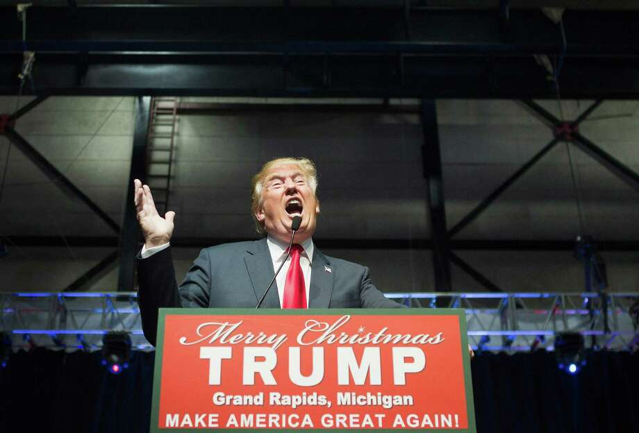 Republican presidential candidate Donald Trump speaks to guests at a campaign rally on December 21, 2015 in Grand Rapids, Michigan. Fifty percent of American voters say they would be embarrassed to have Trump as president, according to a Quinnipiac University National poll released Tuesday, Dec. 22, 2015. Photo: Scott Olson / Getty Images / 2015 Getty Images
