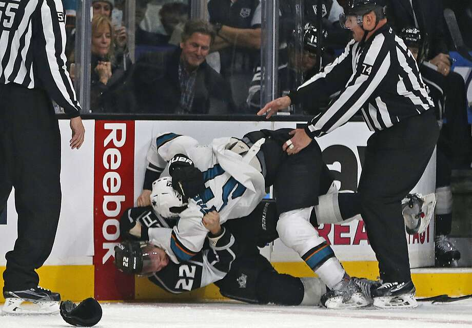 The Kings' Trevor Lewis (22) and the Sharks' Tommy Wingels conclude a fight in the first period at Staples Center. Photo: Gina Ferazzi, McClatchy-Tribune News Service