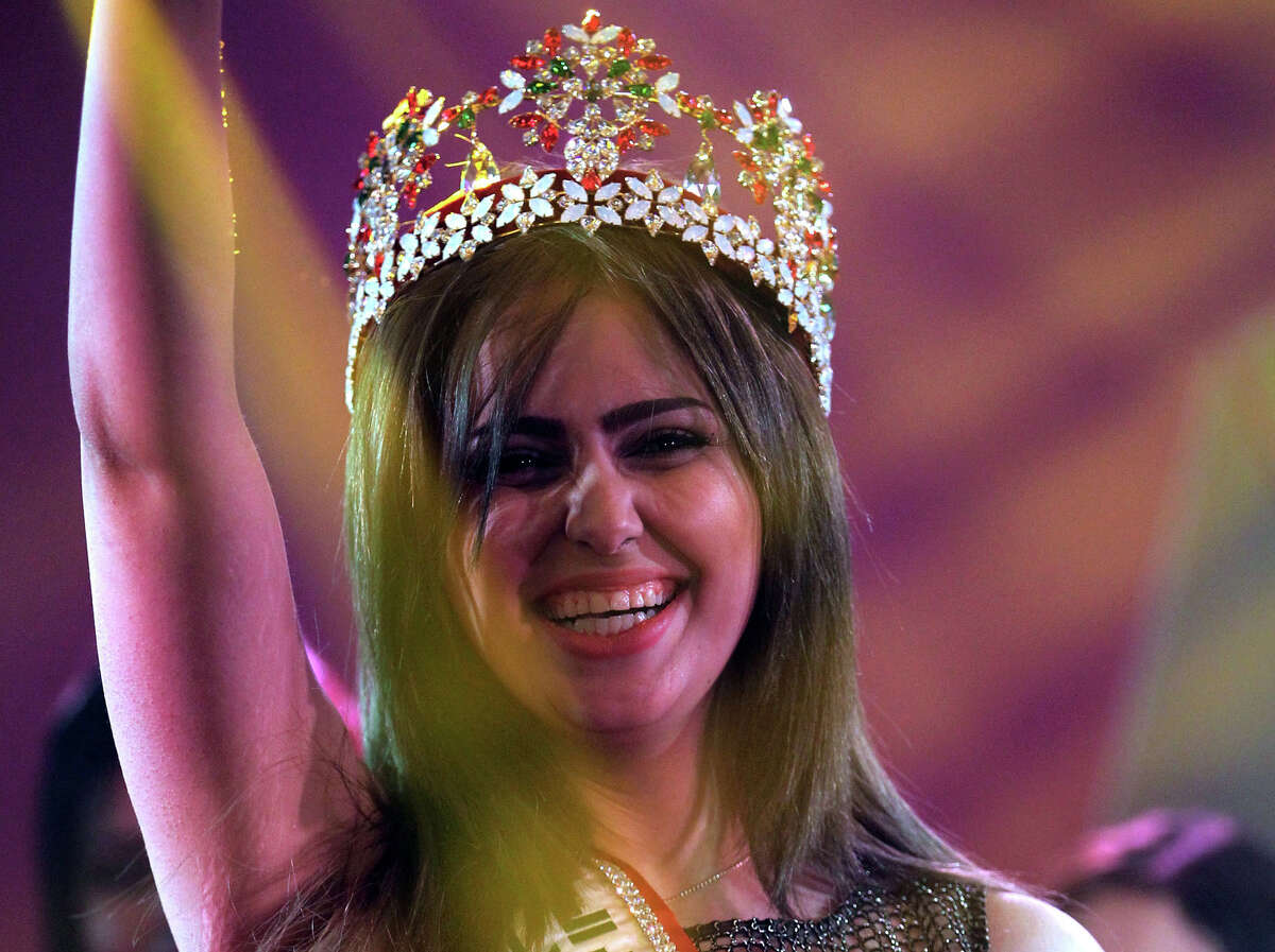 Iraqi Shaymaa Qasim, from the multi ethnic city of Kirkuk, waves after winning the Miss Iraq beauty contest on December 19, 2015 in the capital Baghdad. The beauty contest is the first one in more than 40 years to take place in the war torn country. PHOTOS: See the women who competed in Miss Universe 2015 ...