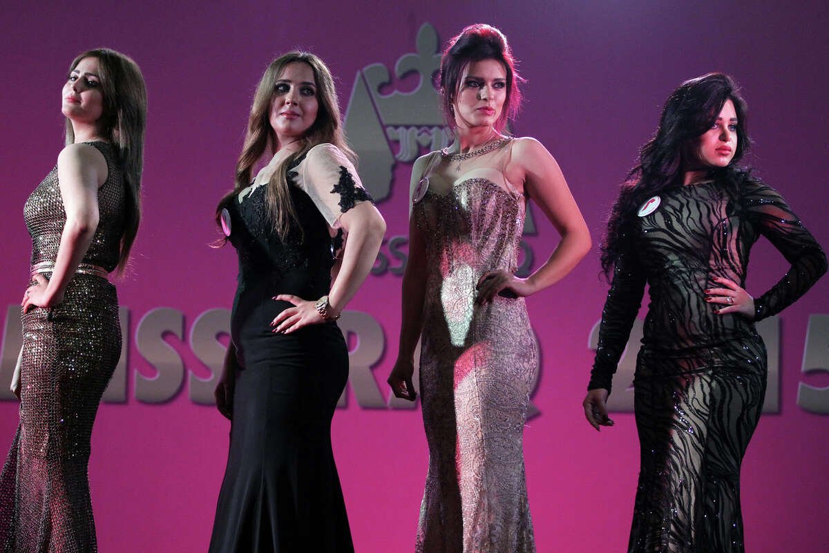 Iraqi women taking part in the Miss Iraq beauty contest pose on stage on December 19, 2015 in the capital Baghdad. The beauty contest is the first one in more than 40 years to take place in the war torn country.