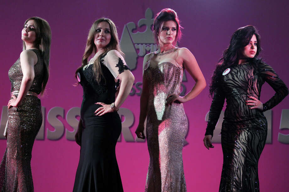 Iraqi women taking part in the Miss Iraq beauty contest pose on stage on December 19, 2015 in the capital Baghdad. The beauty contest is the first one in more than 40 years to take place in the war torn country. Photo: AHMAD AL-RUBAYE, Getty Images / AFP