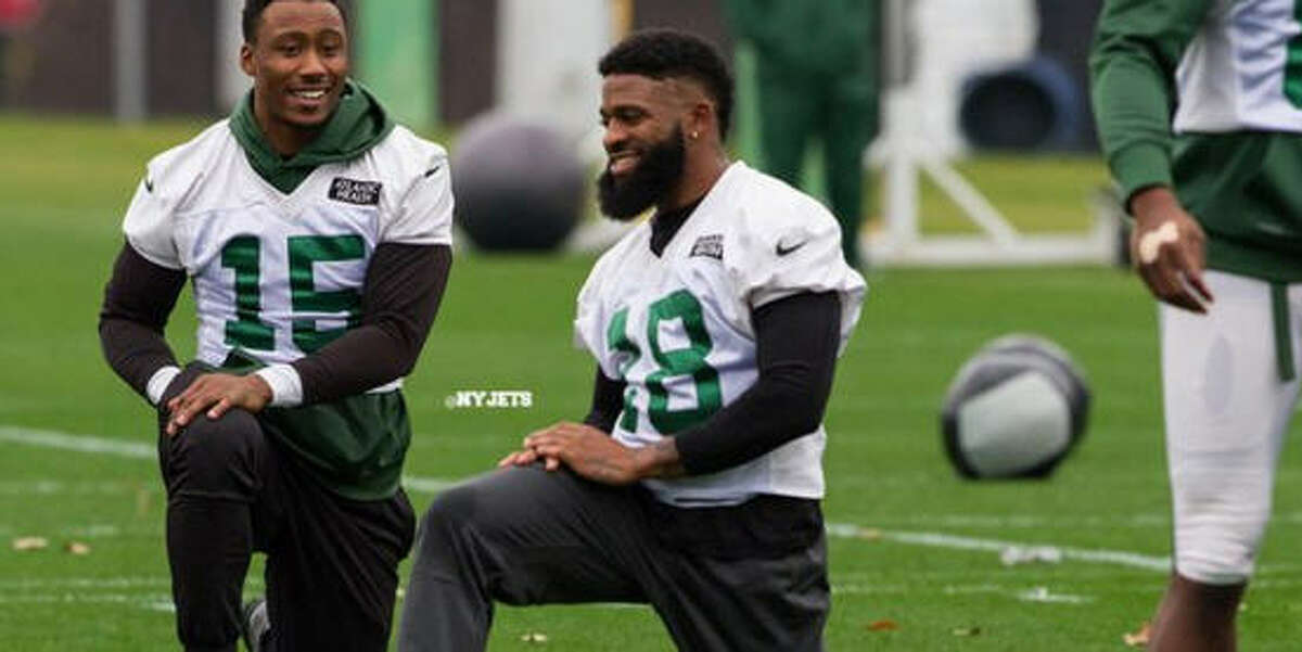 Joe Anderson and Brandon Marshall talk on the New York Jets practice field on Tuesday.