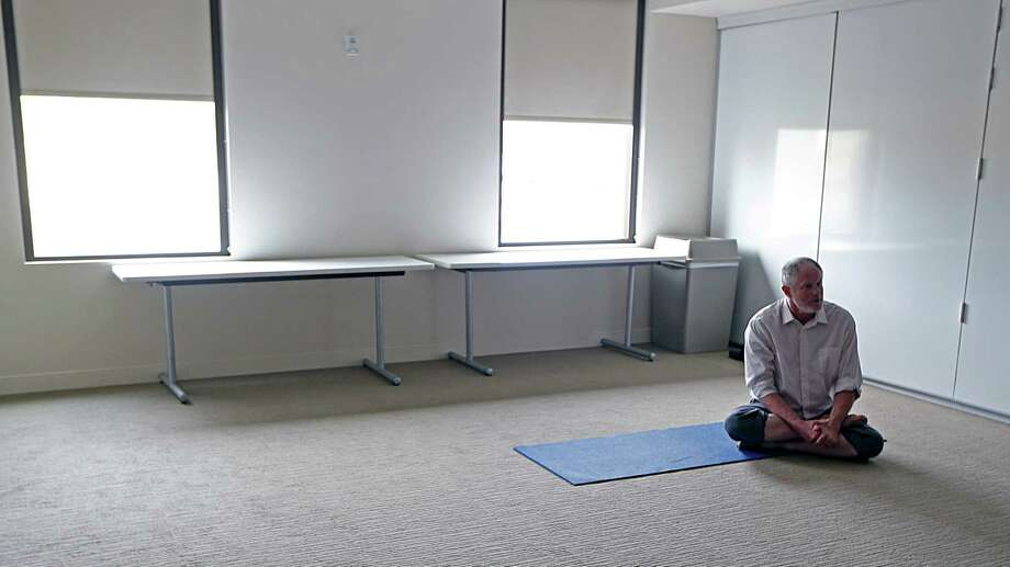 Certified Trauma-Sensitive Yoga instructor Dallas Adams demonstrates a yoga form at the Menninger Clinic Wednesday, Dec. 2, 2015, in Houston. Adams is part of a multi-disciplinary treatment team at the Menninger Clinic.  ( James Nielsen / Houston Chronicle ) Photo: James Nielsen, Staff / © 2015  Houston Chronicle