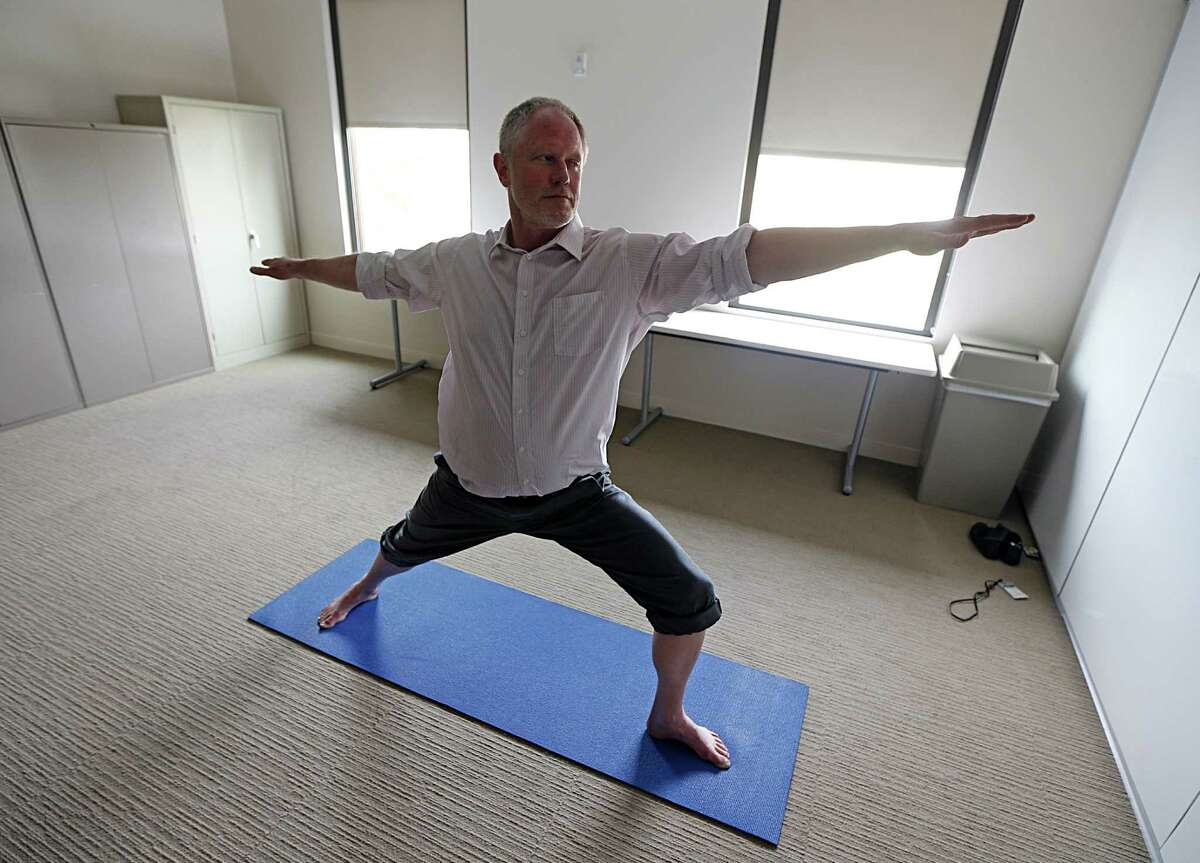 Certified Trauma-Sensitive Yoga instructor Dallas Adams demonstrates a yoga form at the Menninger Clinic Wednesday, Dec. 2, 2015, in Houston. Adams is part of a multi-disciplinary treatment team at the Menninger Clinic. ( James Nielsen / Houston Chronicle )