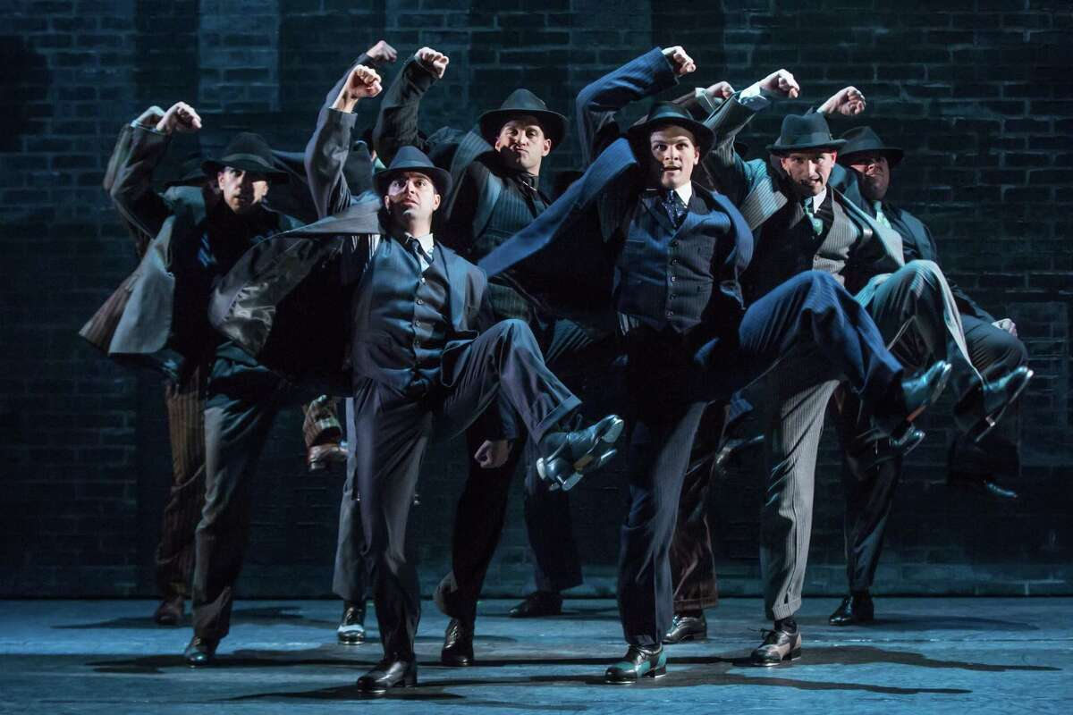 """The chorus of gangsters goes through its paces in the national tour of """"Bullets Over Broadway."""""""