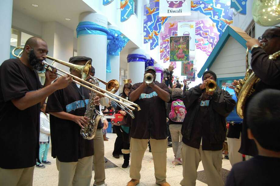 The Children's Museum of Houston is the place to be New Year's Eve as it marks the new year at the stroke of noon. The High Steppers New Orleans-Style Brass Band will lead a parade and the day includes two New York-style shimmering ball drops. Photo: Courtesy Photo