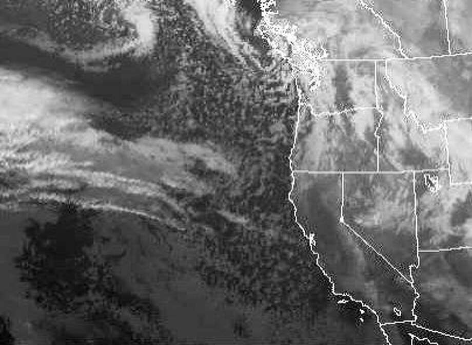 A wet-weather system coming through the Bay Area on Thursday may bring a dusting of snow to the region's highest peaks. Photo: NOAA