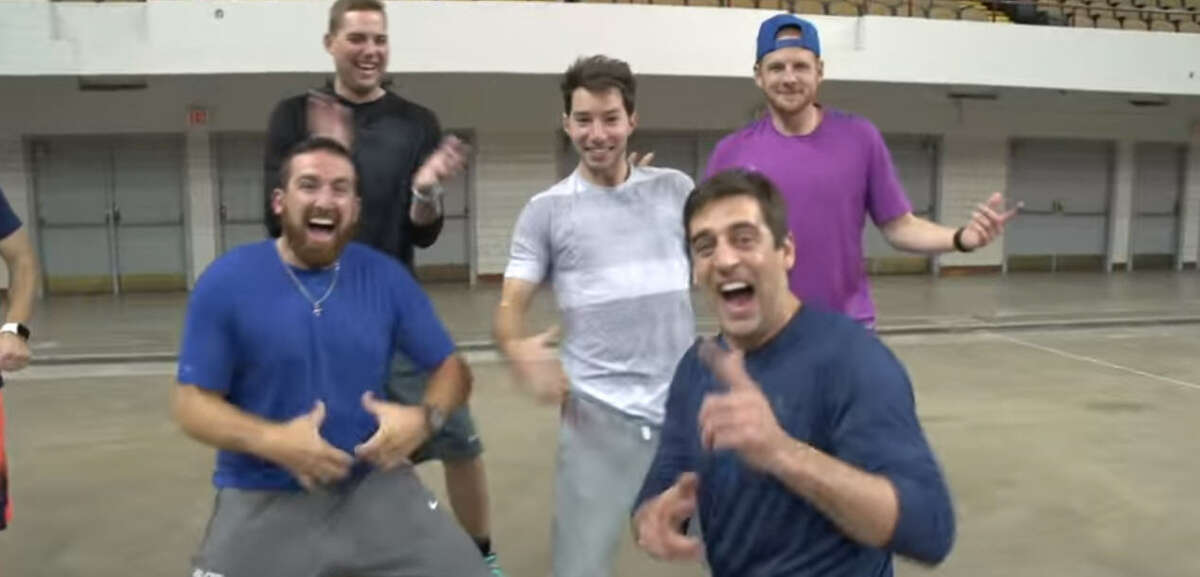 Members of Dude Perfect celebrate with Aaron Rodgers after making a trick shot.
