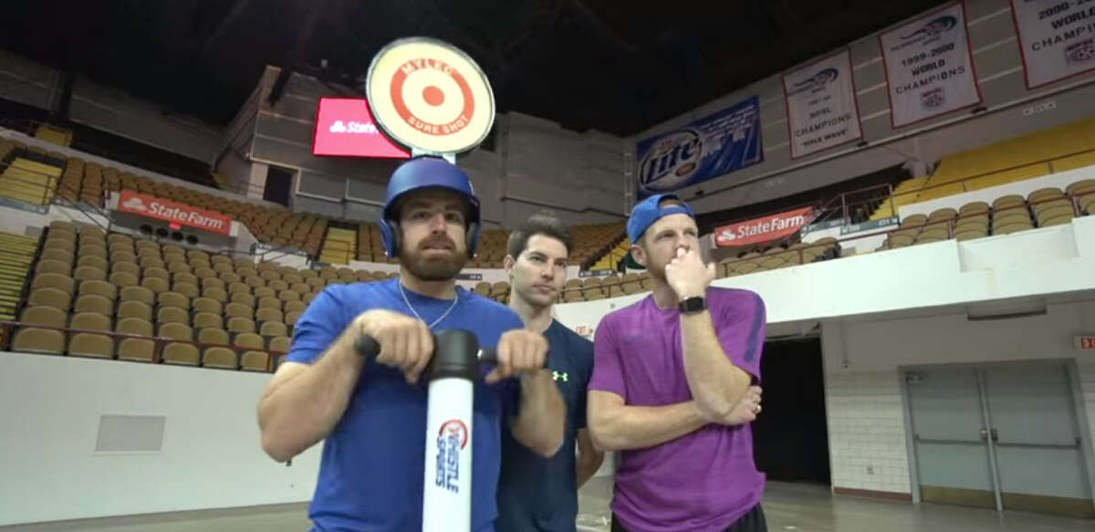 Members of Dude Perfect await a trick shot throw from Aaron Rodgers.